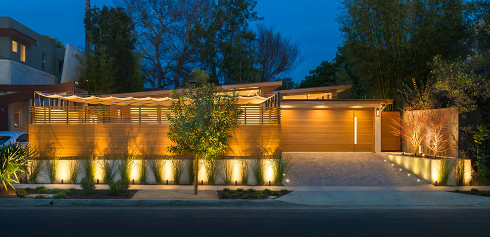 fornt-view-Westgate-Residence-facade-night-view-spotlight-wall-light-wooden-wall-asphalt-road-wooden-fence